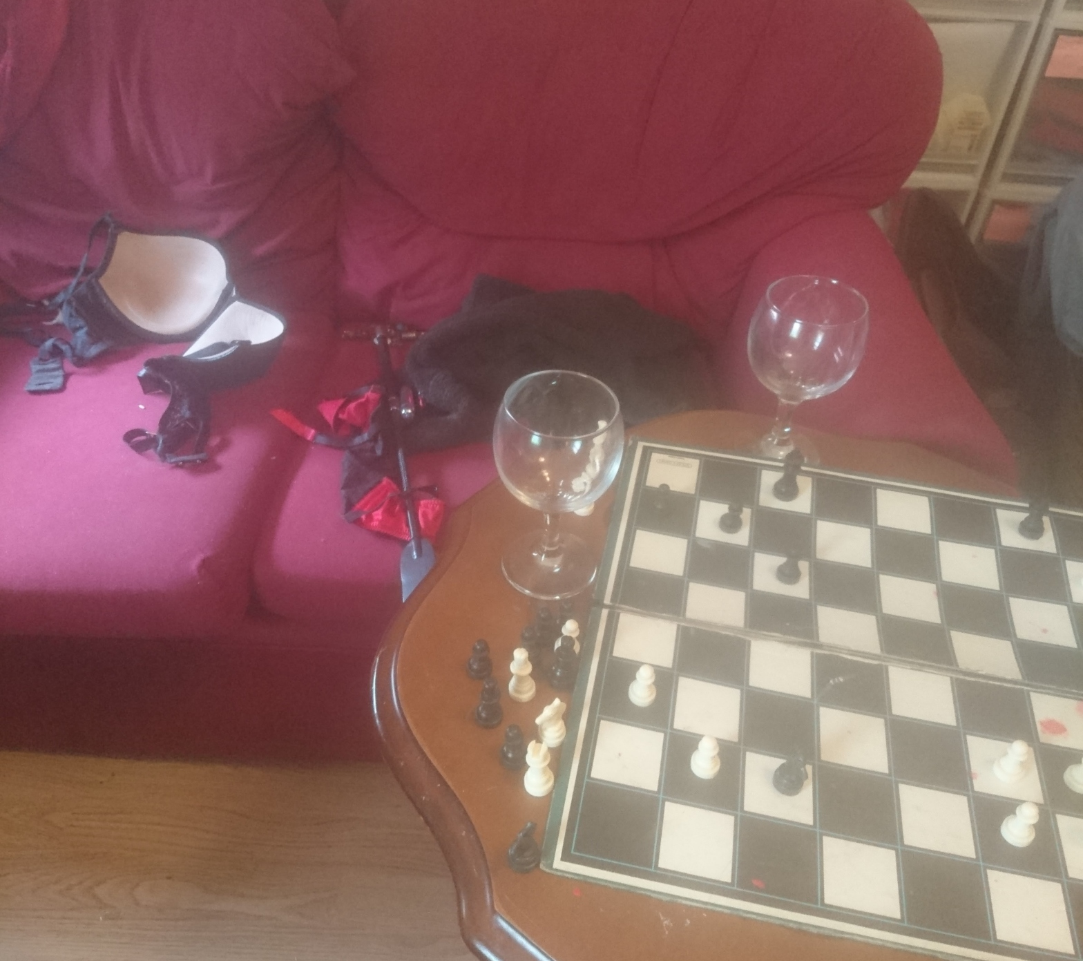 Chessboard, wine glasses, paddle, underwear