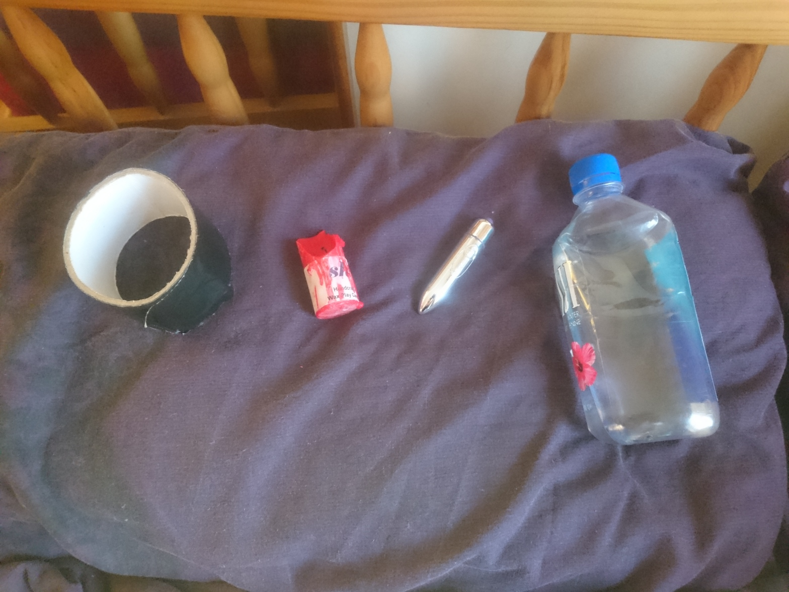 Picture of duct tape, candle, vibrator, and bottle of water