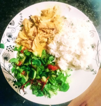 Chicken curry, rice, and salad